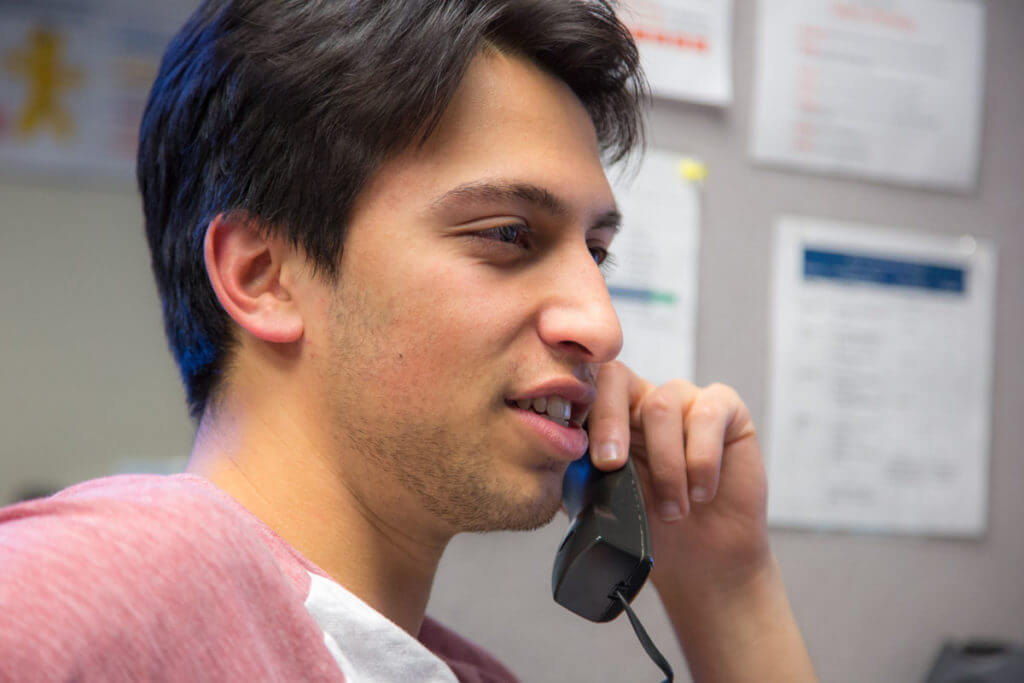 A man talking on the phone.